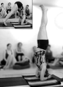 Tiffany Wood demonstrates headstand yoga pose in her Anusara Teacher Training